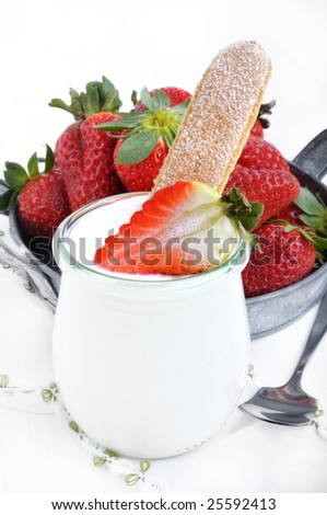 Strawberry and a biscuit with fresh yoghurt - stock photo