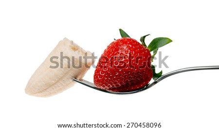 Strawberry and banana on a fork / Fruits - stock photo