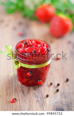 Strawberry and black pepper jam, selective focus - stock photo