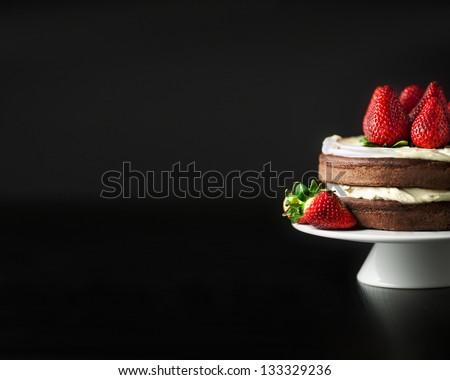 strawberry and chocolate cake with mascarpone black-and background - stock photo