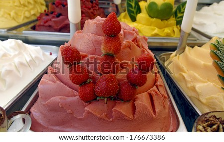Strawberry and fruits ice cream are shown an italian ice cream parlor. - stock photo