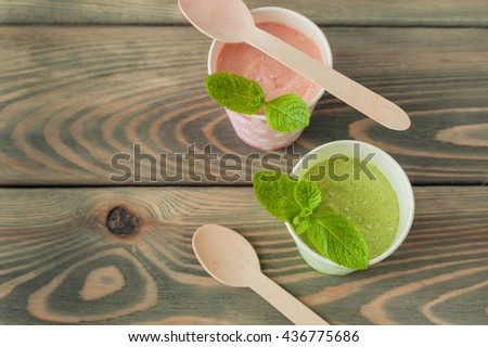 strawberry and mint ice cream in paper cups - stock photo