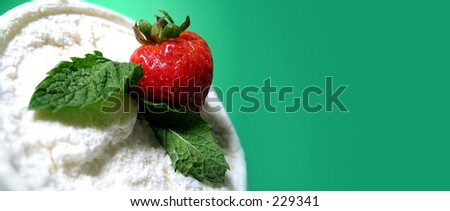 Strawberry and mint leaves with vanilla ice cream. Room at the side for text. - stock photo