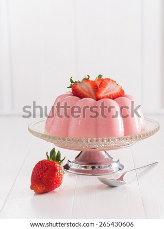 Strawberry blancmange on a plate - stock photo