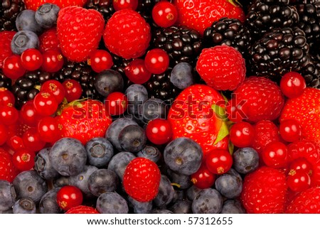 Strawberry blueberry raspberry and blackberries on white background