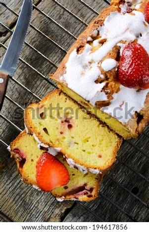 Strawberry bread from above on the wooden table - stock photo