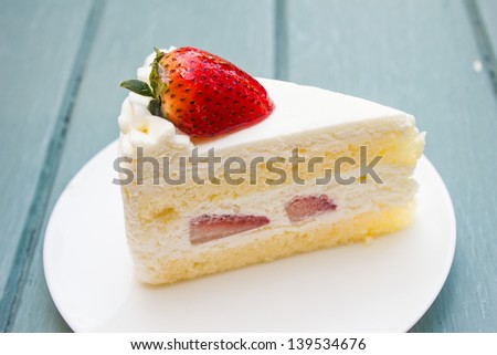 Strawberry cake on white plate - stock photo