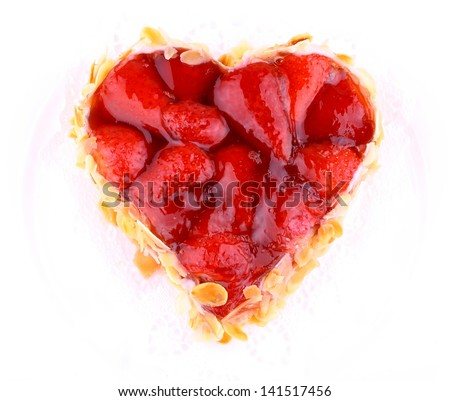 Strawberry cake with almond in heart shape, top view - stock photo