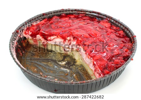 Strawberry cake with frosting on a white background - stock photo