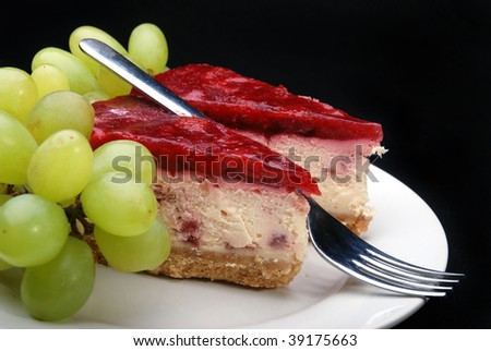 Strawberry cheesecake and grapes.
