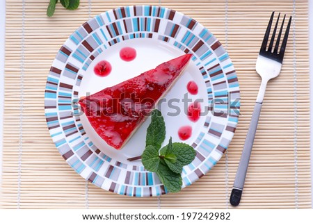 Strawberry cheesecake on plate top view - stock photo