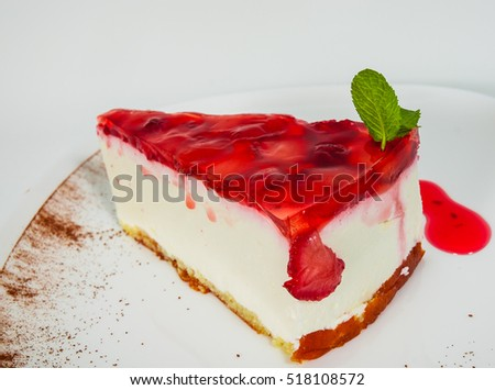 Strawberry cheesecake served on white plate