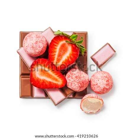 Strawberry chocolate bar, pralines and fruit. Delicious dessert. Objects isolated on white background, clipping path included. Top view, flat lay - stock photo