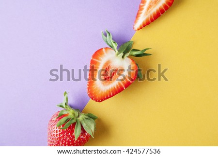 Strawberry close-up on yellow violet background, fruits summer - stock photo