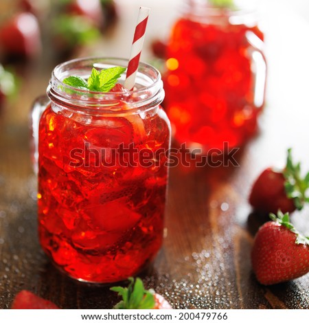 strawberry cocktail in jar with deep red color - stock photo