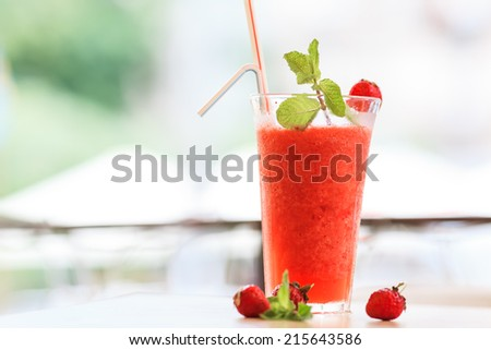Strawberry cocktail with crushed ice and mint - stock photo