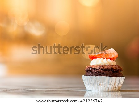 strawberry cupcake with mini blackboard in cafe - stock photo