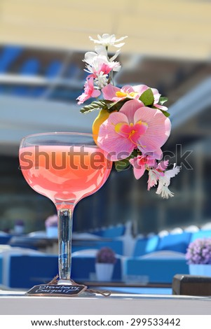 Strawberry Daiquiri Cocktail decorated with pink orchid flowers in a bar on the beach - stock photo