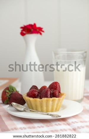 strawberry dessert, milk and flower on the table - stock photo