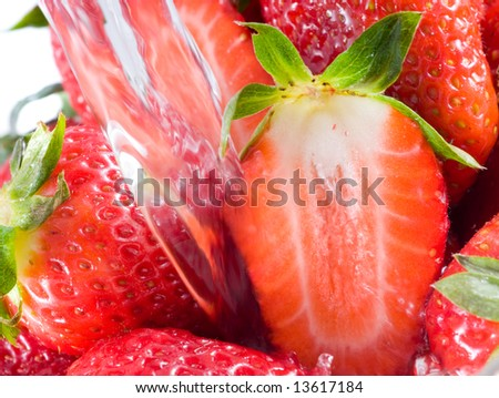 Strawberry falling in juice - stock photo