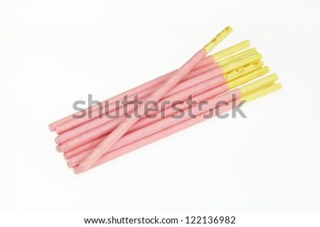 Strawberry flavored bread sticks - stock photo