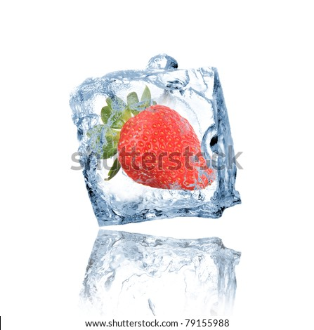Strawberry frozen in ice cube - stock photo