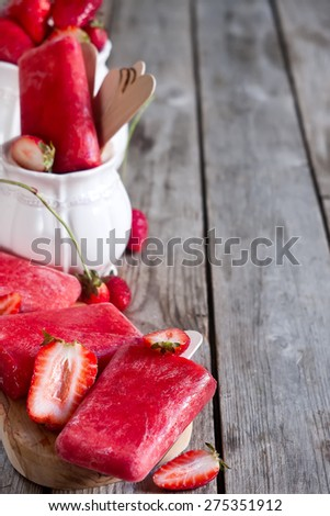 Strawberry homemade ice pops - popsicles - with fresh ripe berries. Copy space background. - stock photo