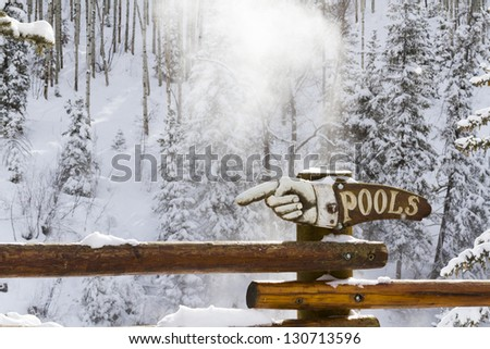 Strawberry Hot Springs surrounded by winter forest. - stock photo