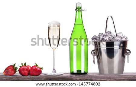 strawberry, ice bucket  with bottle of champagne and glass on a table isolated on a white baclground