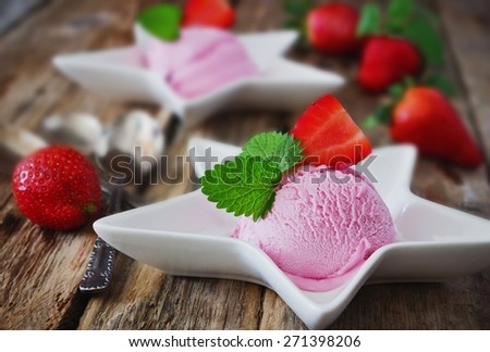 strawberry ice cream and fresh ripe strawberries on a wooden table.selective focus - stock photo