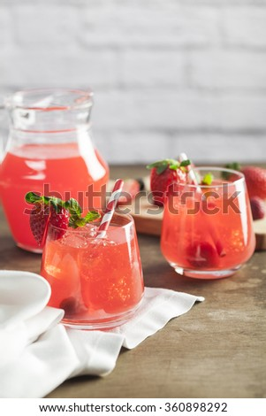 Strawberry iced drink in a wooden table - stock photo
