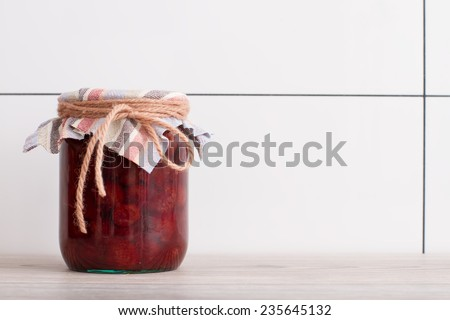strawberry in a glass jar close up - stock photo