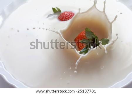 Strawberry in milk - stock photo