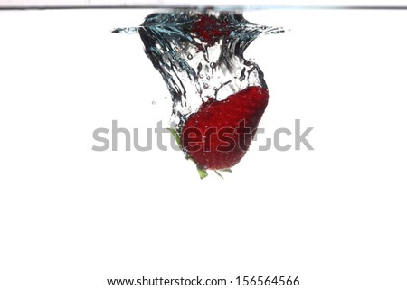 strawberry in the water splash over white background. Healthy food and active life.