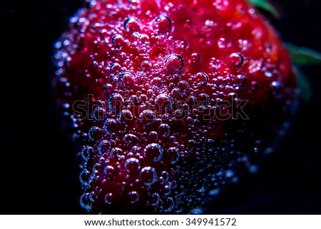 strawberry in water. Washing fruits - stock photo