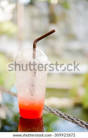 Strawberry italian soda on wood table - stock photo