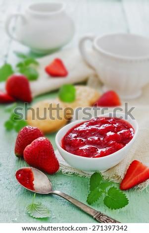 strawberry jam and fresh ripe strawberries on the table. grandma's jam. selective focus - stock photo