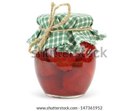 Strawberry jam in glass jar on white background - stock photo