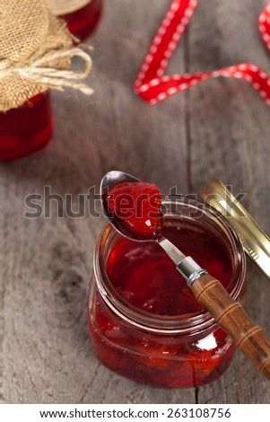 Strawberry Jam on old wooden background. Selective focus. - stock photo