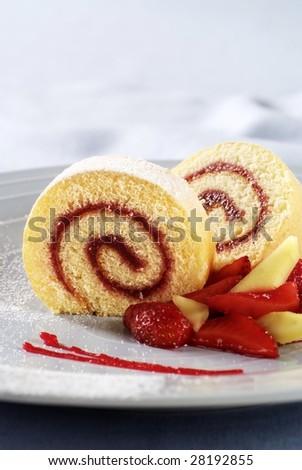 Strawberry jam Swiss roll - stock photo