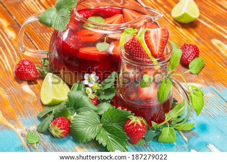 Strawberry juice with fresh strawberries and lime - stock photo