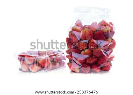 strawberry juicy fruit in plastic bag packaging isolated - stock photo