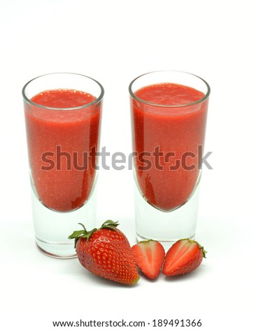 strawberry milkshake in two glasses isolated in white