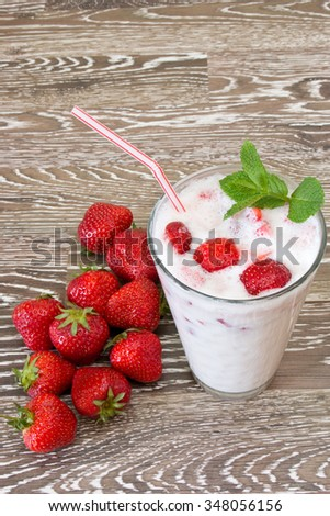 Strawberry milkshake with fresh fruits and mint leaves
