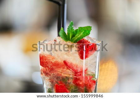 Strawberry mohito cocktail with ice and mint - stock photo