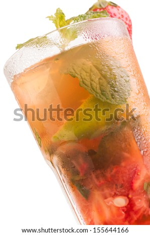 Strawberry Mojito cocktail close up, a Cuban cocktail made with cuban rum, lime, sugar , a splash of soda and flavoured with fresh strawberry - stock photo