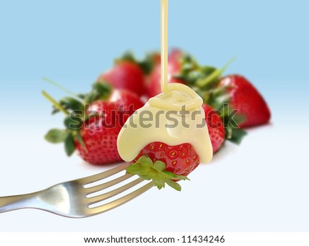 Strawberry on a fork - stock photo