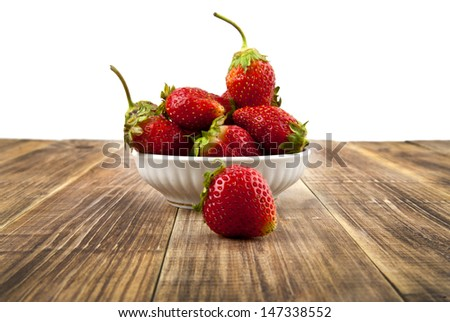 strawberry on a wooden table - stock photo