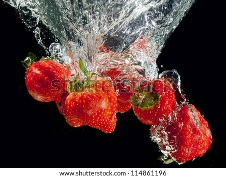 Strawberry on black splashing! - stock photo