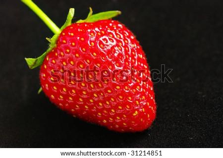 Strawberry on the black background - stock photo
